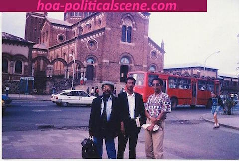 hoa-politicalscene.com/asmara.html - Asmara: Main street and Cathedral view with journalist Khalid Mohammed Osman, his brother chancellor Mubarak and his friend artist Salih Tahir stading.
