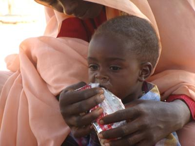Darfur child receiving a nutritional supplement