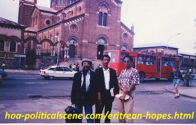 hoa-politicalscene.com/eritrean-hopes.html - Eritrean hopes: Journalist Khalid Mohammed Osman with his brother chancellor Mubarak and friend artist Altahir Salih in front of the Cathedral in Asmara.